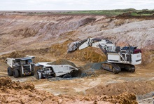 Liebherr R9800 Excavator and dump trucks for mining