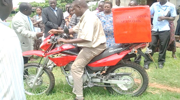 CARES Initiative Hub sample collector on motorbike in Uganda