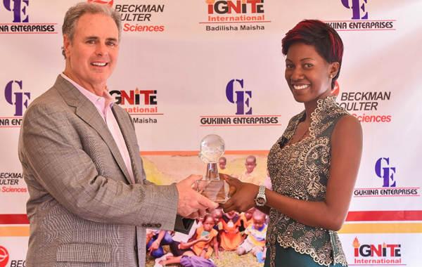 Evah Namakula Receiving Cares Award