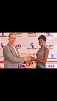 Evah Namakula Receiving Cares Award