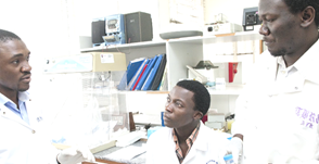 CARES Solutions Men talking in lab