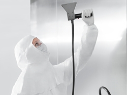 cleanroom technician using filter probe for environmental monitoring air particle counts
