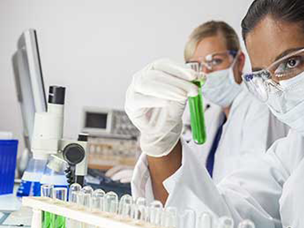 Clinician looking at chemicals